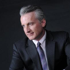 David J Cummins Seated Suit Hands Crossed